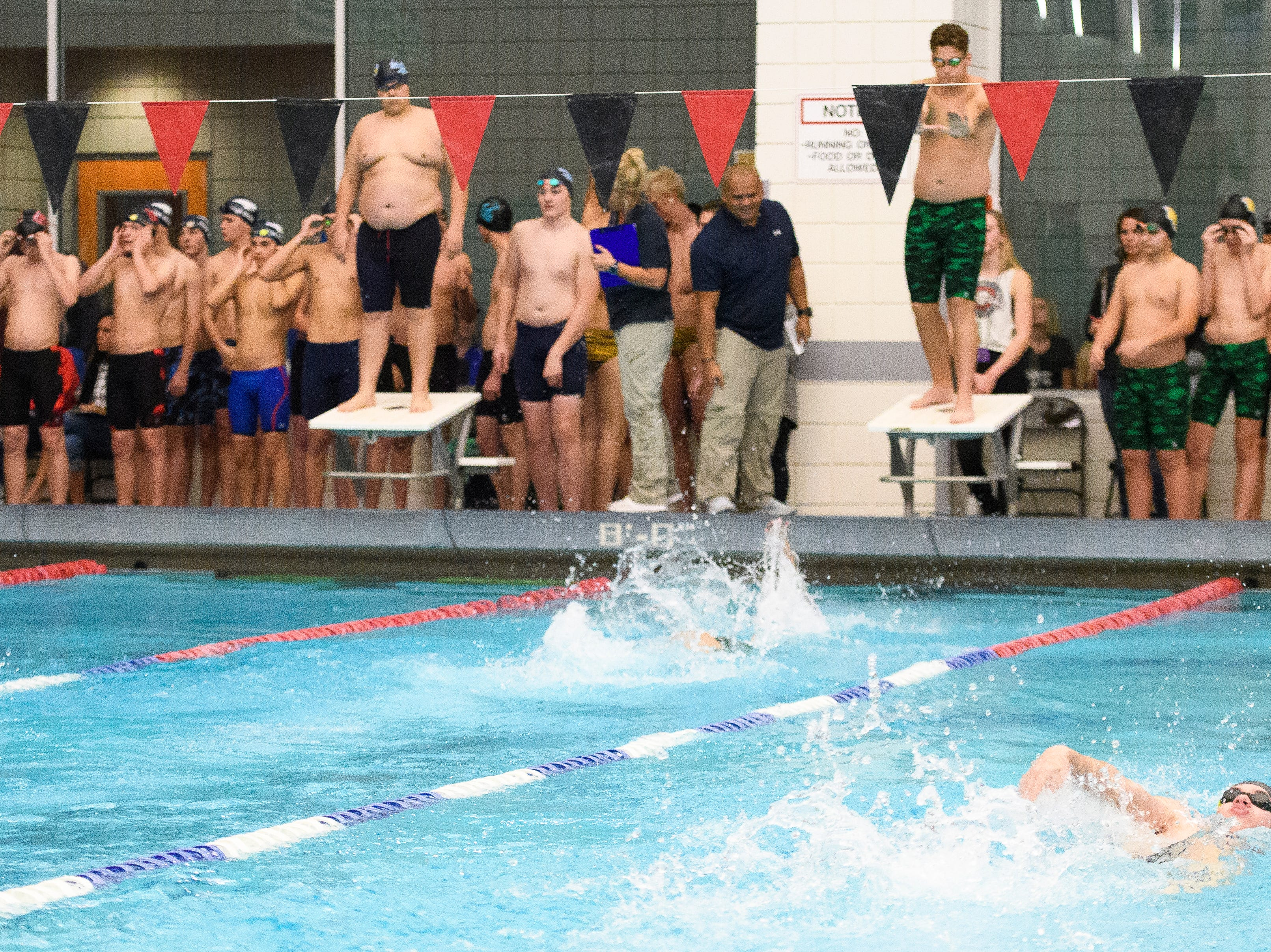 Swimmers compete during the Canyon View Invitational at Southern Utah University Friday, November 30, 2018. Hundreds of swimmers from Region 9 competed at the event.