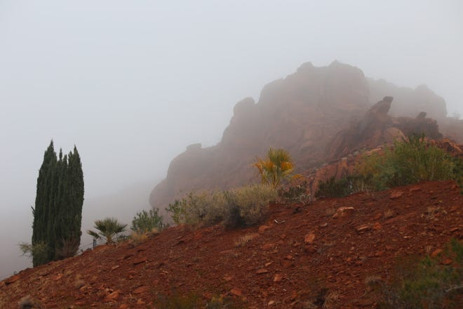 Fog obscures the red rock hills near 500 North and 100 West in St. George on the morning of Dec. 1, 2018.