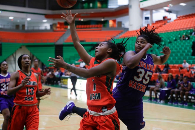 Florida A&M guard Mya Moye (1) shoots the ball during a game between Florida A&M and Edward Waters College Saturday, Dec. 1, 2018 at the Al Lawson Center.