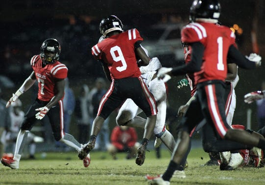 NFC defensive back Deandrae McCray gets in the way of Victory Christian running back Cornelius Shaw. The Eagles limited the Storm's big rusher in a 23-20 win in a Class 2A state semifinal.
