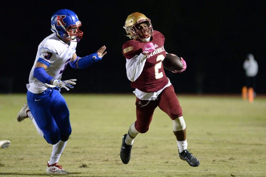 Javan Morgan (2) of Florida High rushes by King's Academy's Jeremiah Scroggins (3) during the Class 3A state semifinal on Friday, Nov. 30, 2018.