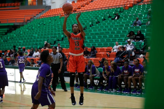 Florida A&M forward Dy'Manee Royal shots a jumper over a defender from Edward Waters College.