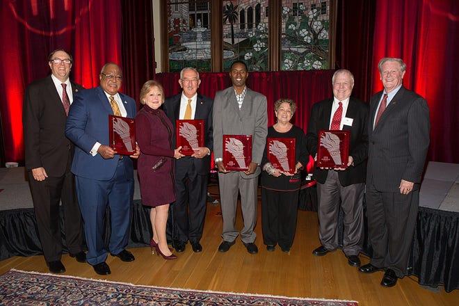 FSU Faculty Senate President Todd Adams, far left, and FSU President John Thrahser, far right, with this year's Torch Award winners,  Melvin Stith, Nan and Mark Hillis; Charlie Ward; Val Richard Auzenne (accepting for Barry Jenkins); and Don Gibson.
