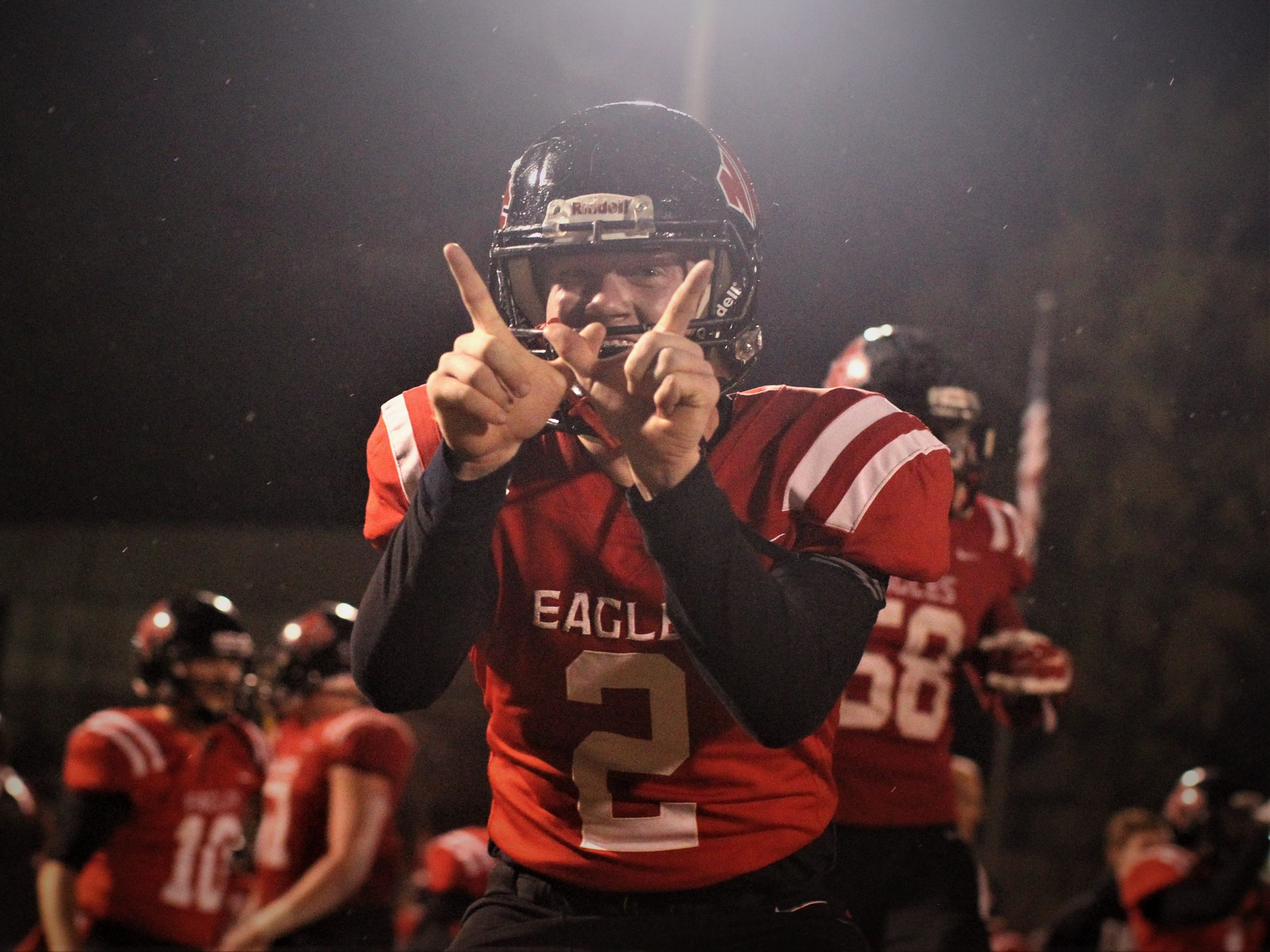 NFC senior wide receiver E.C. Presnell celebrates a 23-20 win over Victory Christian in a Class 2A state semifinal.