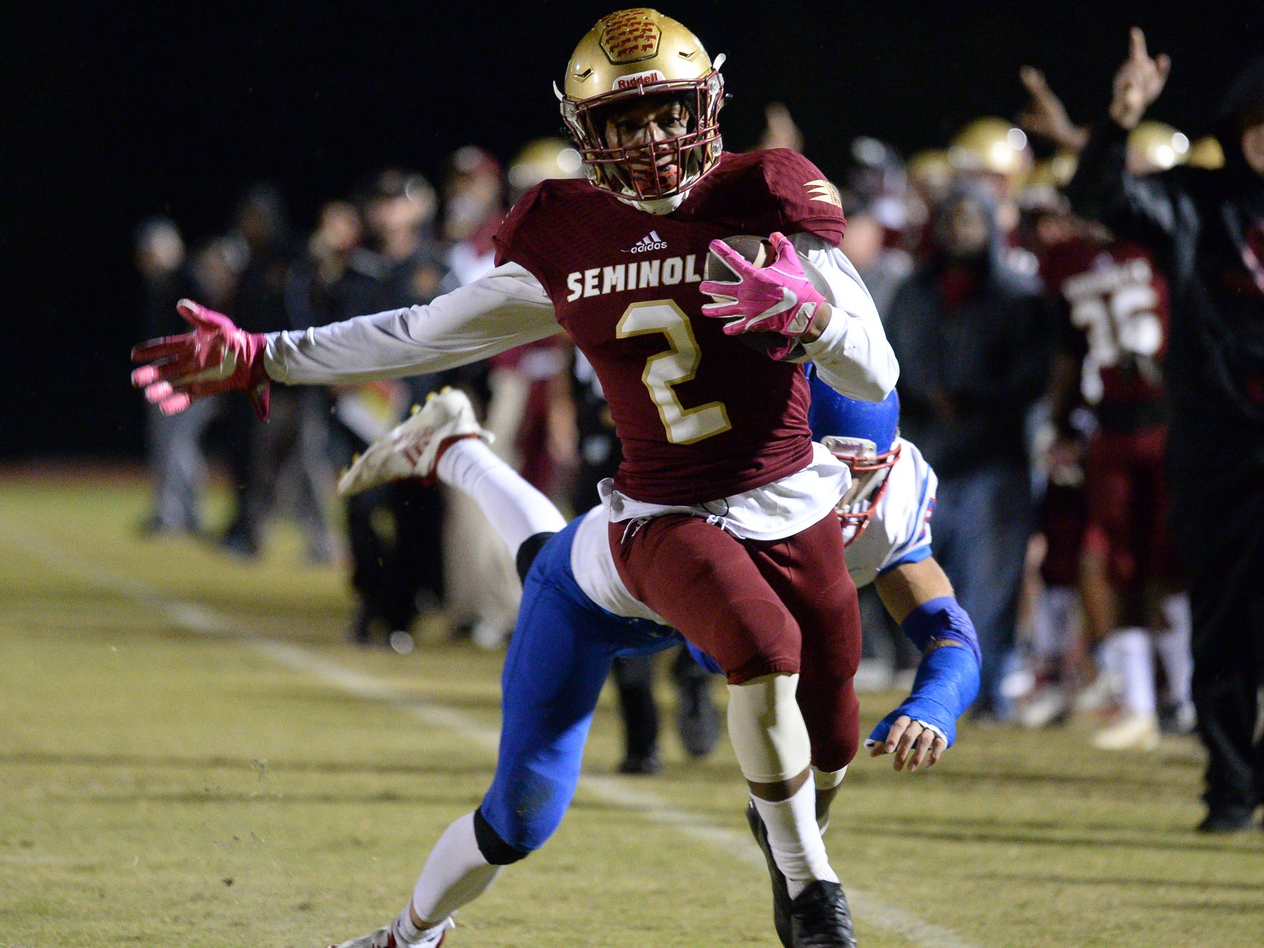 Florida High's Javan Morgan carries the ball for a touchdown against King's Academy Lions in the Class 3A state semifinal on Nov. 30, 2018.