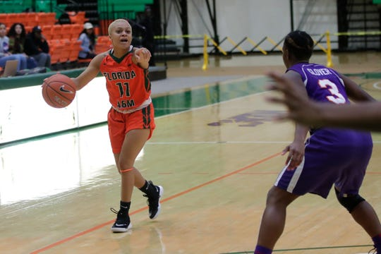 Florida A&M guard Morgan Mitchell calls out assignments for the Rattlers against Edward Waters.
