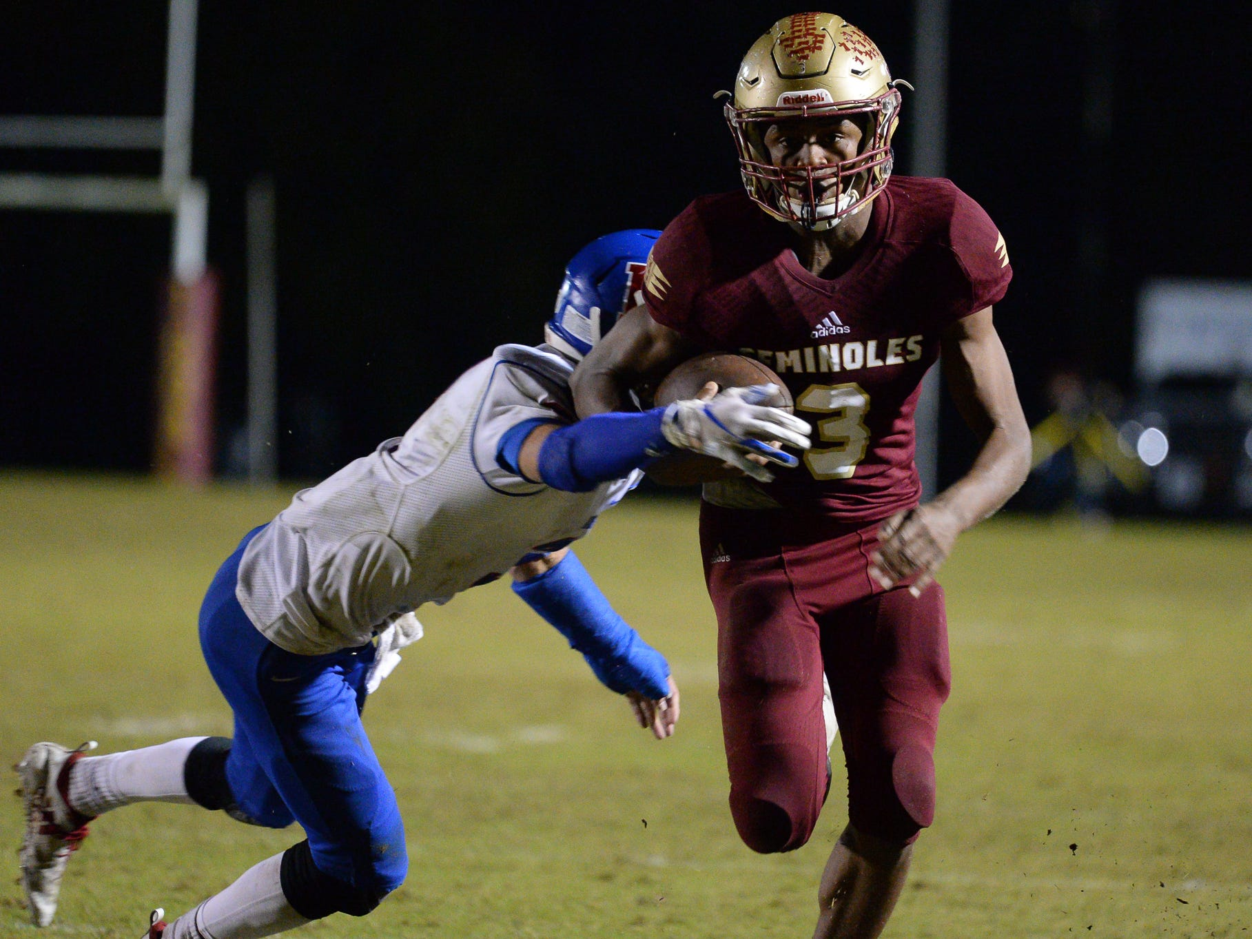 Florida High's Ahmari Harvey takes off upfield for a touchdown catch during the Seminoles' 49-48 loss to King's Academy in a Class 3A state semifinal.