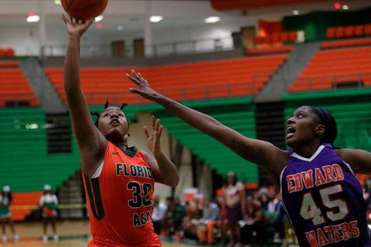 Florida A&M guard/forward Jasmine Ballew (30) puts up a shot over Le'Terra Ransom of Edward Waters College. Ballew had 14 points and six rebounds in FAMU's 70-64 win.