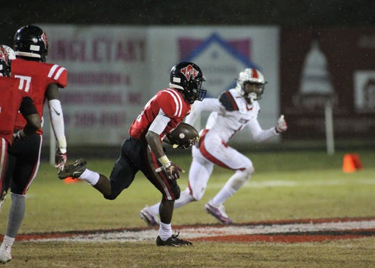 NFC senior Von Hayes returns a kickoff 80 yards for a touchdown in the fourth quarter of the Eagles' 23-20 win over Victory Christian in a Class 2A state semifinal.