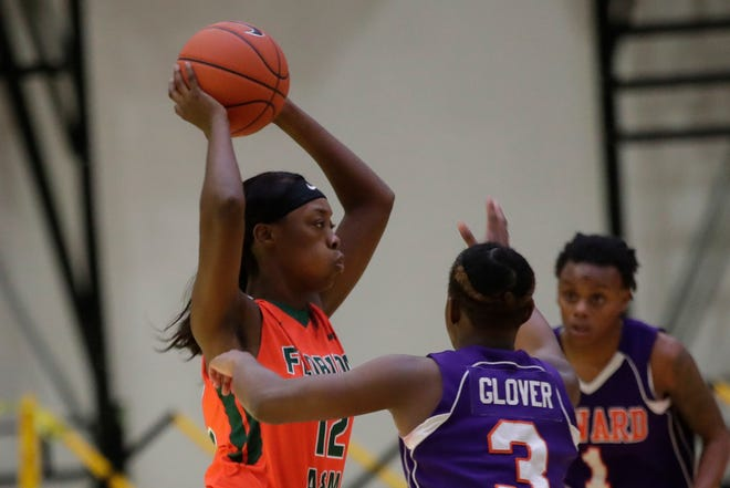 Florida A&M's Keziah Dilworth passes out of a double team set by Edward Waters College.