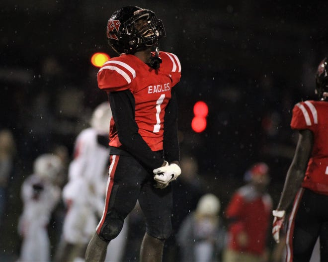 NFC senior Deangelo Mitchell celebrates a late defensive stop that helped the Eagles beat Victory Christian 23-20 on Friday night in a Class 2A state semifinal.