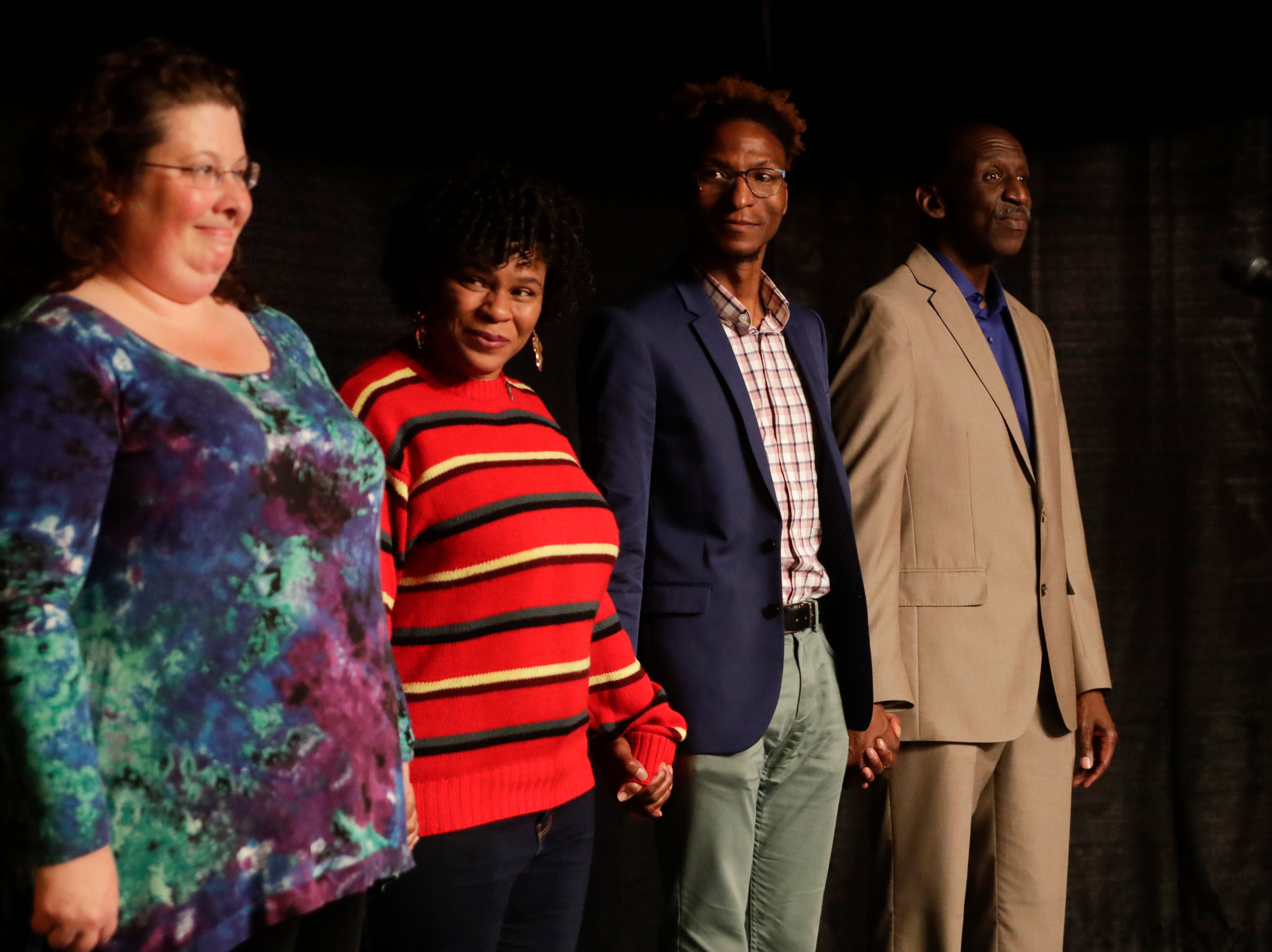 "The storytellers come together on the stage after sharing during the Storytellers event ""In the Blink of an Eye: Stories of Tragedy, Triumph and Transformation"" at the American Legion Post 13 in Tallahassee Friday, Nov. 30, 2018."