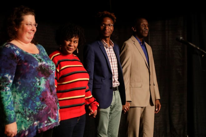 """The storytellers come together on the stage after sharing during the Storytellers event """"In the Blink of an Eye: Stories of Tragedy, Triumph and Transformation"""" at the American Legion Post 13 in Tallahassee Friday, Nov. 30, 2018."""
