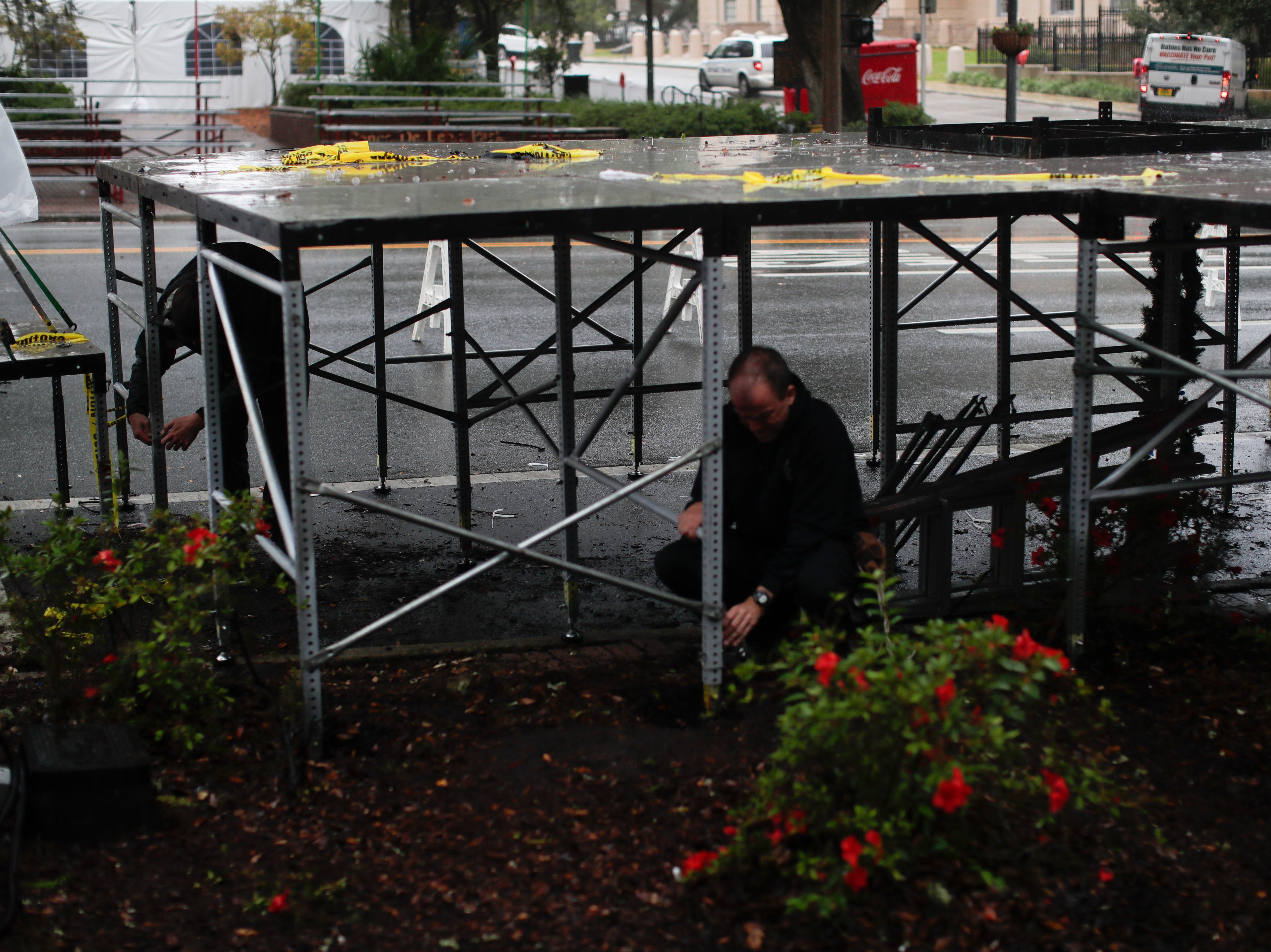 A stage is deconstructed in the Chain of Parks after it was announced that Tallahassee's Winter Festival was canceled Saturday, Dec. 1, 2018.
