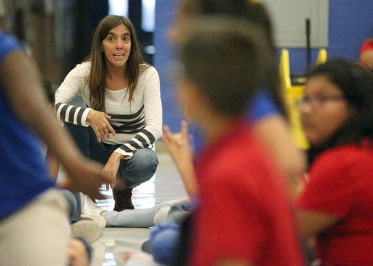 Actor/teacher Micaela Gramajo works with a group of Crosby Elementary School students Nov. 30.