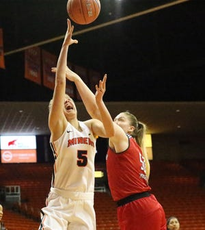 Zuzanna Puc, 5, of UTEP drives for a layup against Madison Heckert, 50, of Arkansas State in a recent game.