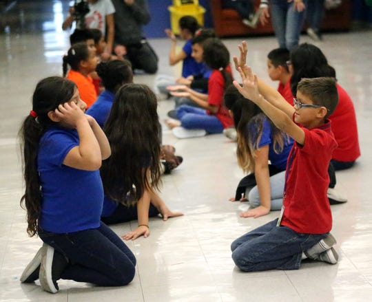 A group of Crosby Elementary School students go through acting drills.