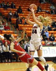 Katarina Zec, 44, of UTEP draws a charging foul on Payton Tennison, 5, of Arkansas State while driving for a layup recently.