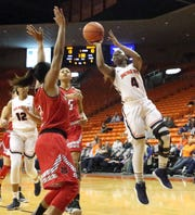 Neidy Ocuane, 4, of UTEP drives for a shot against Arkansas State on Saturday in El Paso.