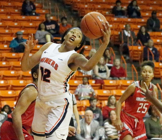 Ariona Gill, 12, of UTEP grabs an offensive rebound against Arkansas State recently in the Don Haskins Center.