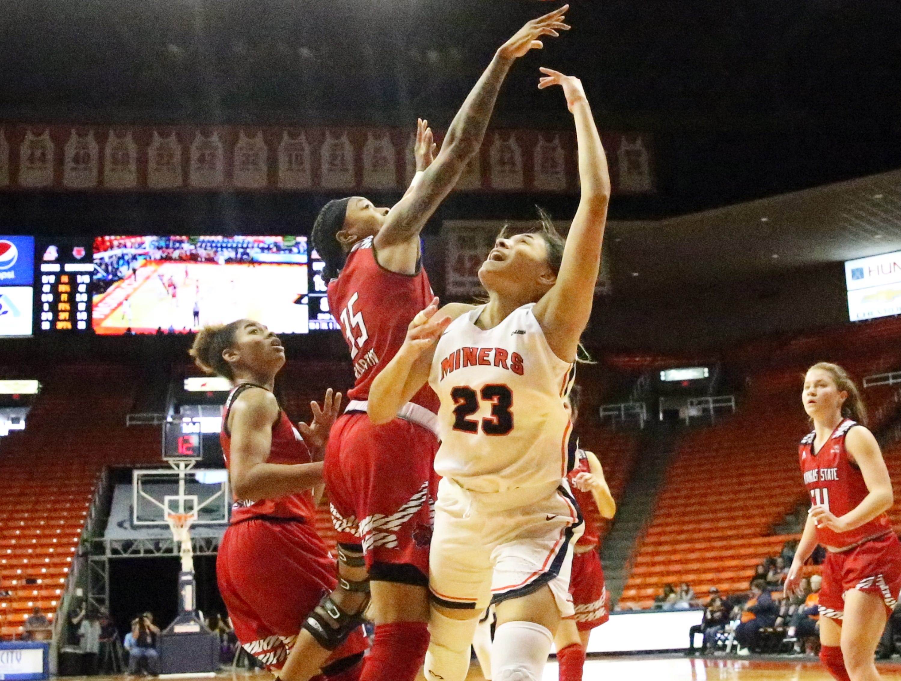 UTEP guard Alexa Hoy gets the ball rejected by Peyton Martin, 35, of Arkansas State on Saturday in the Don Haskins Center.