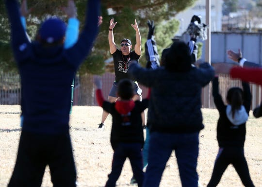 A trainer Saturday limbers up walkers at Memorial Park before the start of the first AIDS Walk put on by the Border AIDS Partnership.