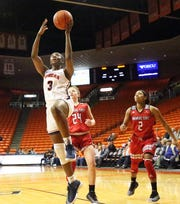 Jordan Alexander, 3, of UTEP drives for 2 points against Arkansas State on recently in the Don Haskins Center.