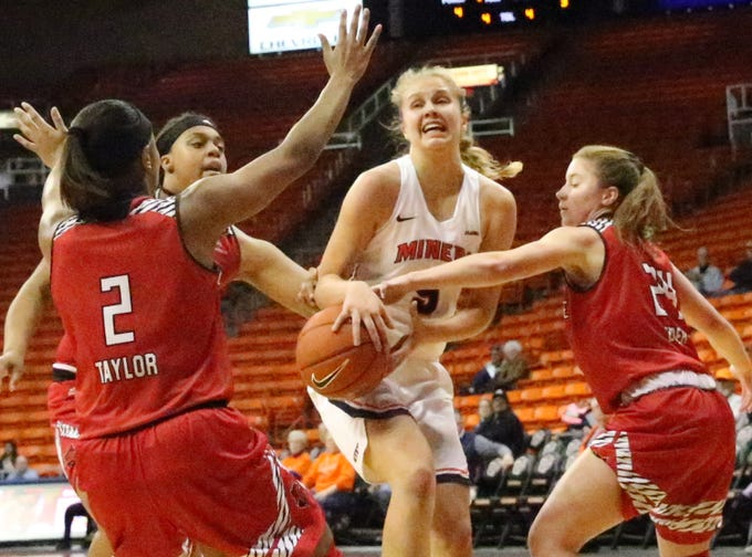 UTEP forward Zuzanna Puc, center, gets the ball stripped by Arkansas State while driving for a layup in the Don Haskins Center.