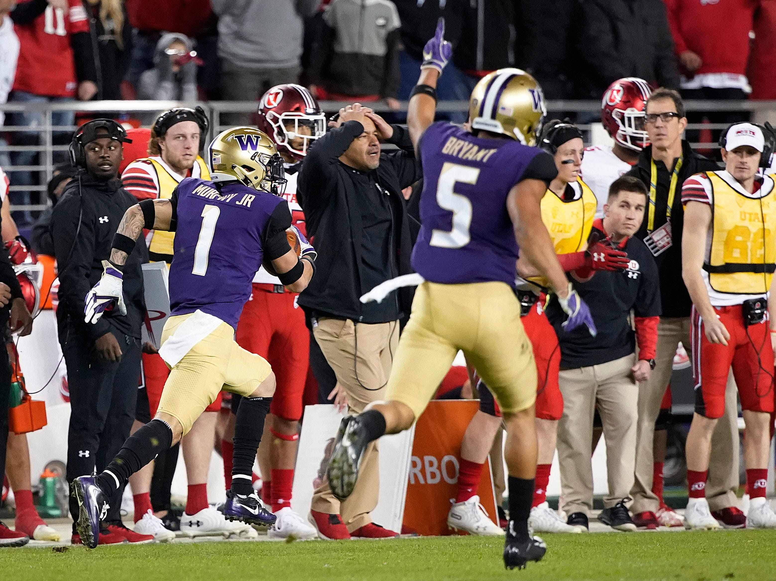 Washington defensive back Myles Bryant (5) celebrates as defensive back Byron Murphy (1) returns an interception for a touchdown against Utah during the second half of the Pac-12 championship game in Santa Clara on Friday night.