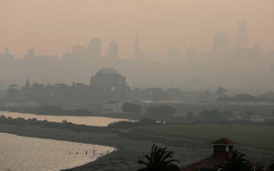 In this Nov. 19 photo, the San Francisco skyline is obscured due to smoke and haze from wildfires. U.S. Interior Secretary Ryan Zinke says wildfires in California in 2018 released roughly the same amount of carbon emissions as are produced each year to provide electricity to the state.