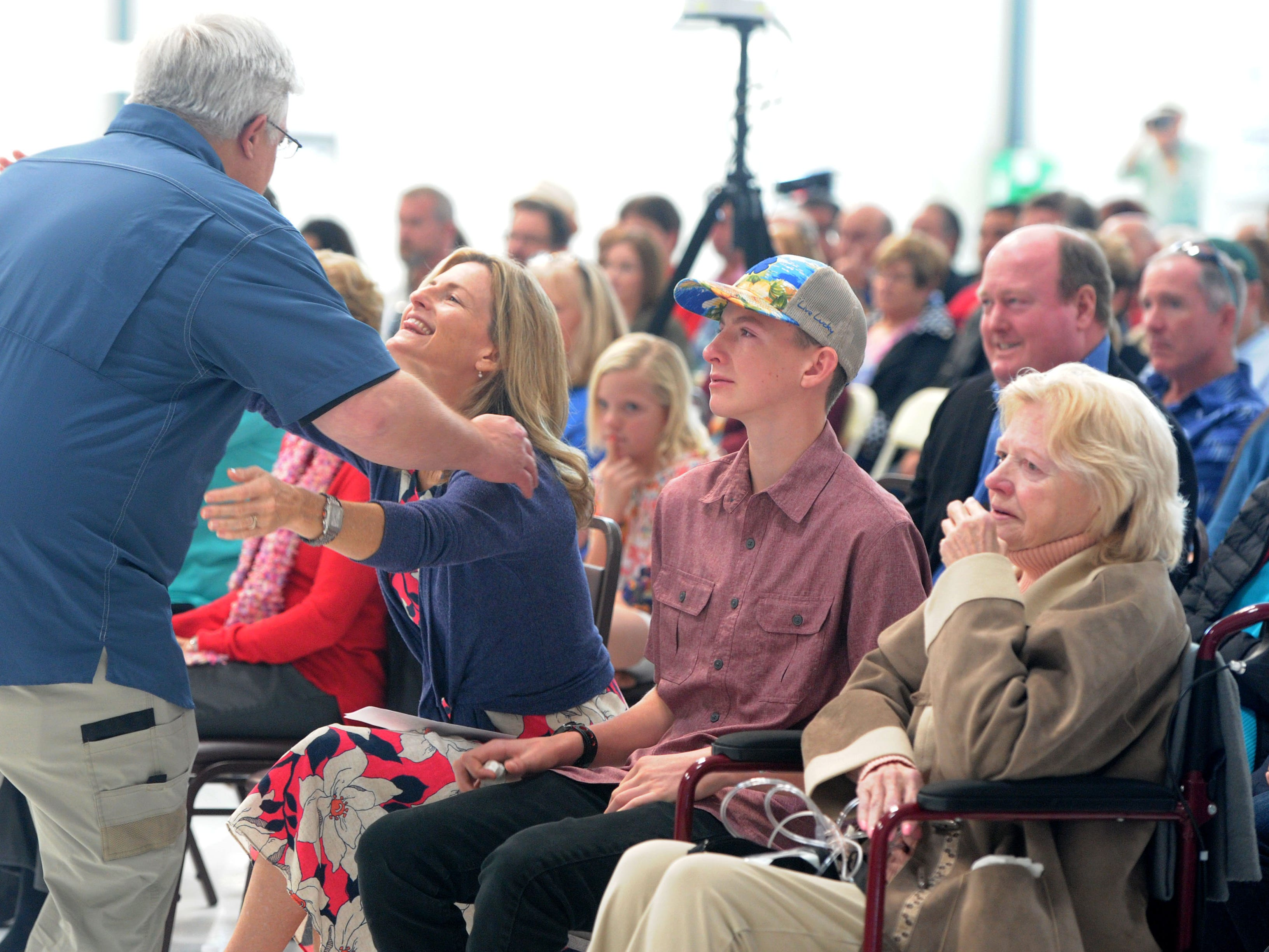 Nick Altizer, hugs Ann McNamee after his speech during a ceremony remembering her late husband, Todd McNamee, at the Camarillo Airport.