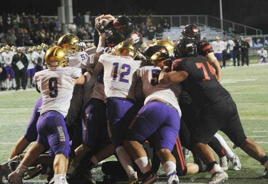 Grace Brethren quarterback Mikey Zele is stopped at the goal line by St. Augustine during the CIF-State Division 2AA SoCal Regional championship Friday night at Cal Lutheran. Grace Brethren won 28-14 and will play in the CIF-State Bowl Championship on Dec. 14 at Cerritos College.