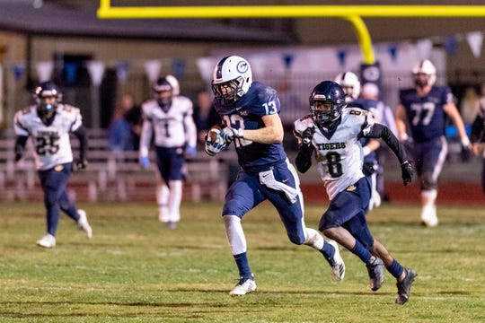 Central Valley Christian's Dustin Van Grouw runs after the catch against Morse in a CIF SoCal Regional Championship Bowl Game on Friday, November 30, 2018.