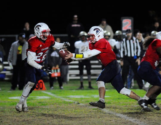 Strathmore Trace Pugh hands off the ball to Alonso Acevedo against Adelanto during a CIF SoCal Regional Championship Bowl Game on November 30, 2018 at Strathmore High School.
