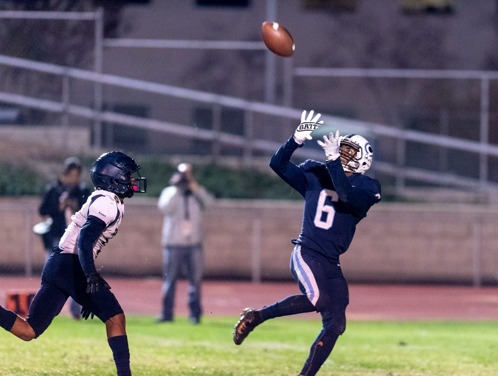 Central Valley Christian's Brian Noel takes a pass from Eric Dragt ahead of Morse's Michael Wright before scoring in a CIF SoCal Regional Championship Bowl Game on Friday, November 30, 2018.