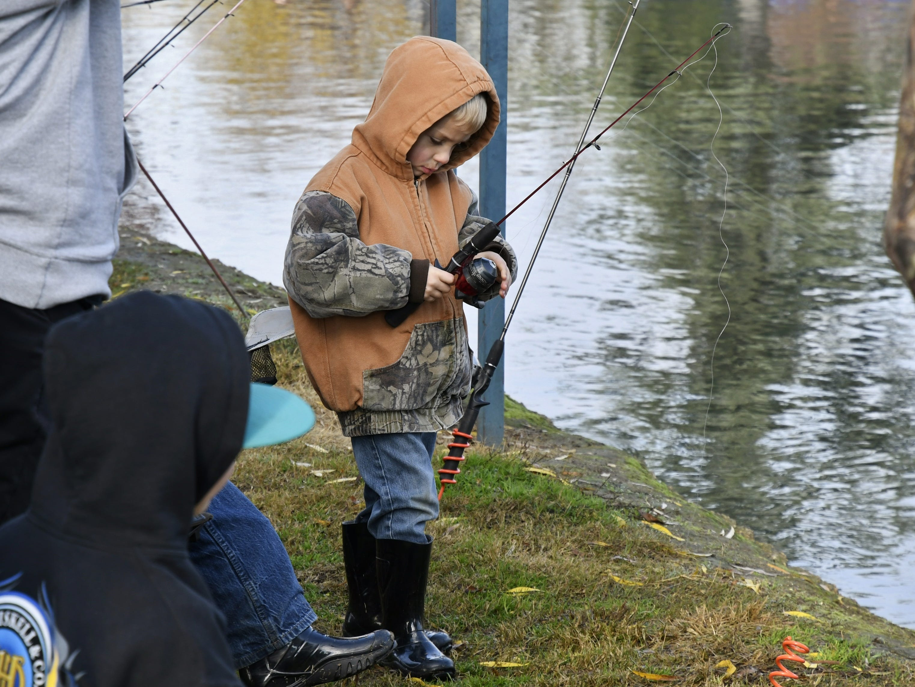 Hundreds of families gather at Del Lago Park to cast a line at the annual Tulare Parks and Recreation Trout Fishing Derby on Saturday, December 1, 2018.
