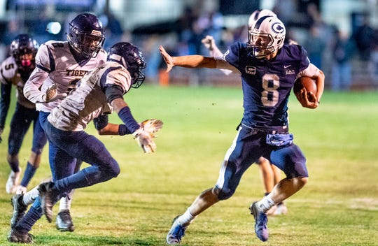 Central Valley Christian quarterback Eric Dragt tries to evade Morse's Jaycob Hicks in a CIF SoCal Regional Championship Bowl Game on Friday, November 30, 2018.