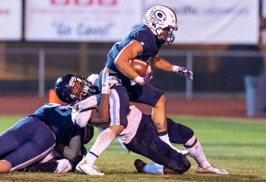 Central Valley Christian's Jaalen Rening muscles his way to a touch down past Morse's Devin Brown in a CIF SoCal Regional Championship Bowl Game on Friday, November 30, 2018.