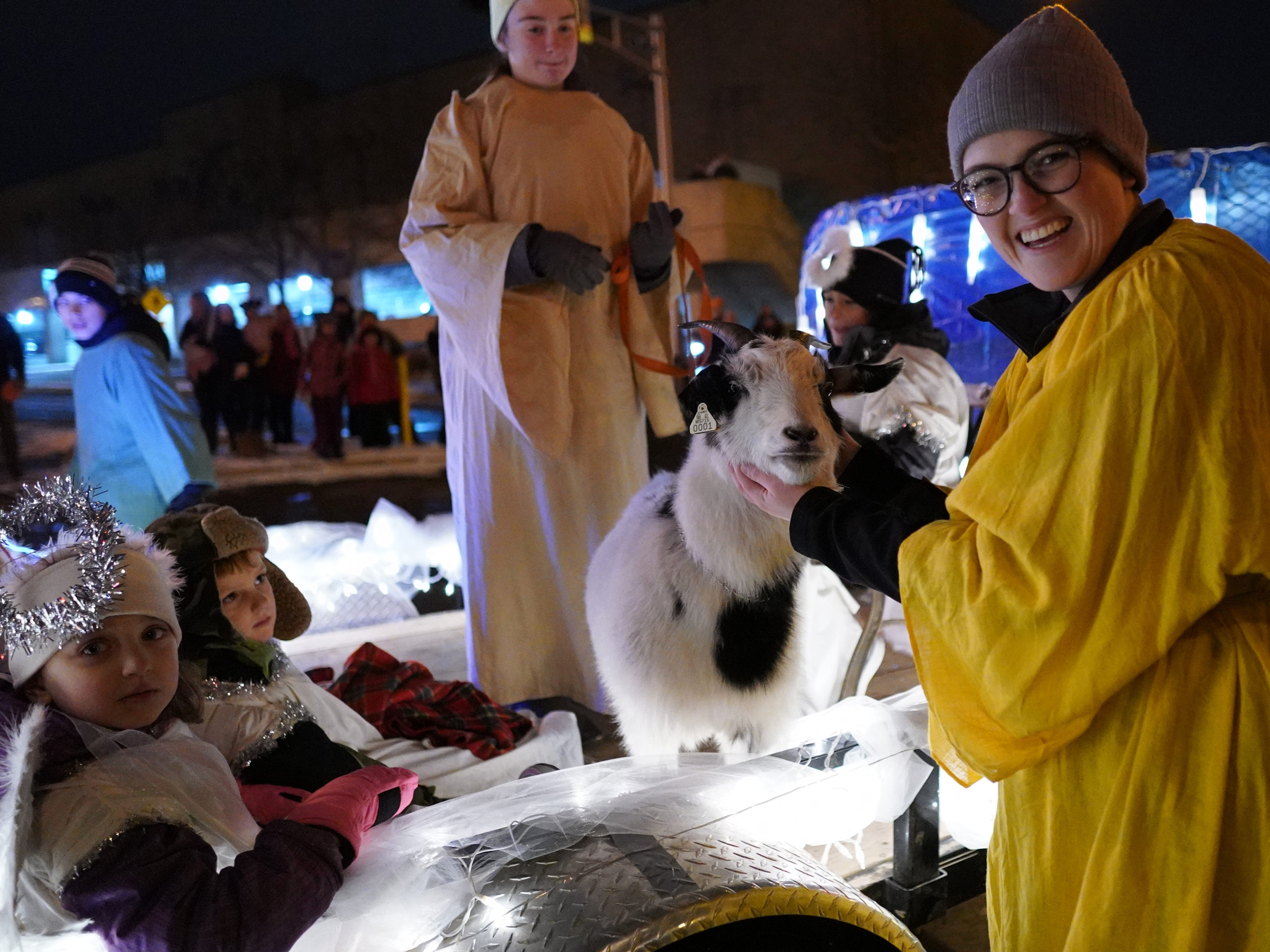 People line alongside the streets to watch the Wausau Holiday Parade flows from the Marathon Park through Stewart Avenue to the 400 Block Friday night in Wausau, Wisc. T'xer Zhon Kha/USA TODAY NETWORK-Wisconsin