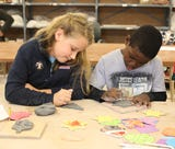 Kids and adults make holiday ornaments from clay at the Clay Art Center in Port Chester.