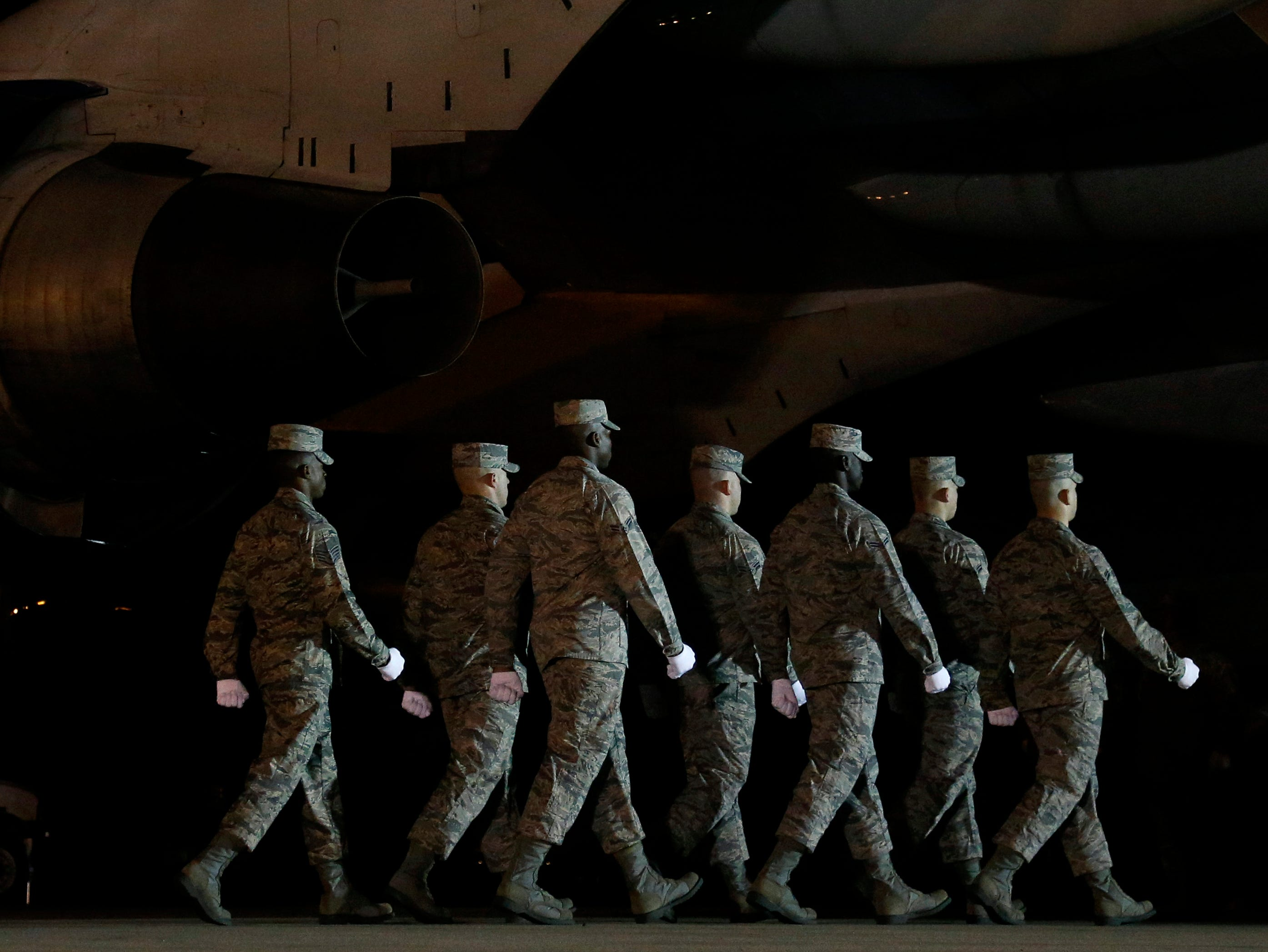 A U.S. Air Force carry team moves toward a transfer case containing the remains of Staff Sgt. Dylan J. Elchin, Friday, Nov. 30, 2018, at Dover Air Force Base, Del. According to the Department of Defense, Elchin, 25, of Hookstown, Pa., was killed Nov. 27, 2018, by a roadside bomb in Ghazni province, Afghanistan.