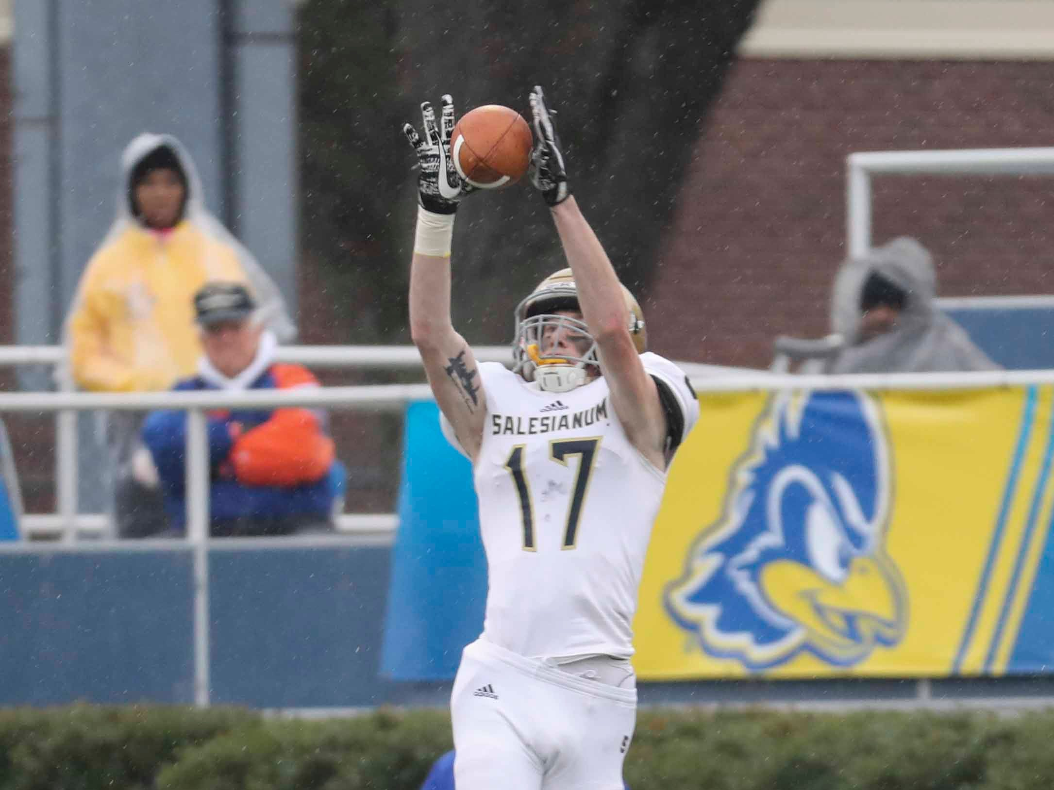 Salesianum's Sean Regan grabs a pass in the third quarter of the Golden Knights' 33-7 win in the DIAA Division I state tournament championship game at Delaware Stadium Saturday.