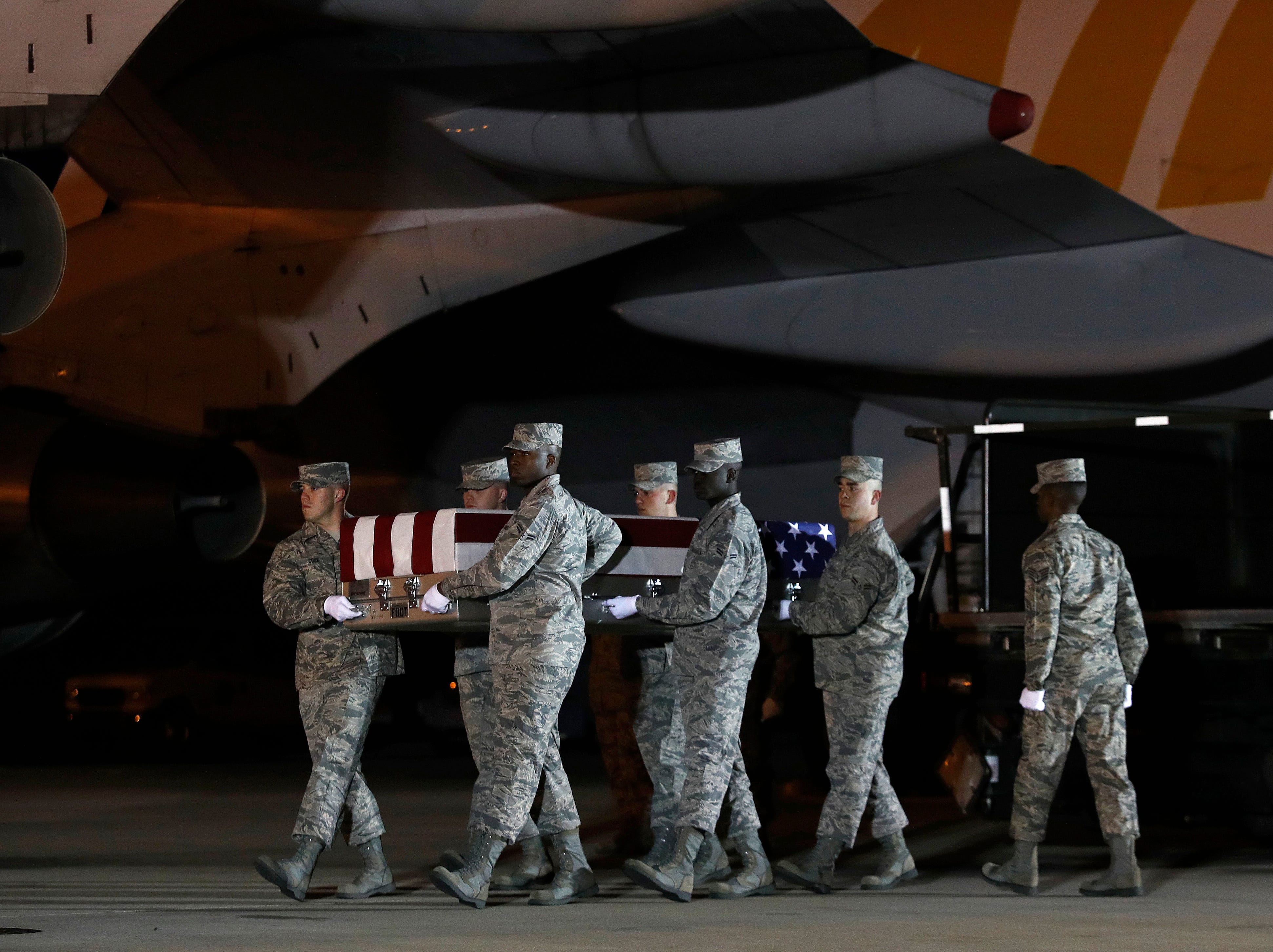 A U.S. Air Force carry team moves a transfer case containing the remains of Staff Sgt. Dylan J. Elchin, Friday, Nov. 30, 2018, at Dover Air Force Base, Del. According to the Department of Defense, Elchin, 25, of Hookstown, Pa., was killed Nov. 27, 2018, by a roadside bomb in Andar, Ghazni Province, Afghanistan.