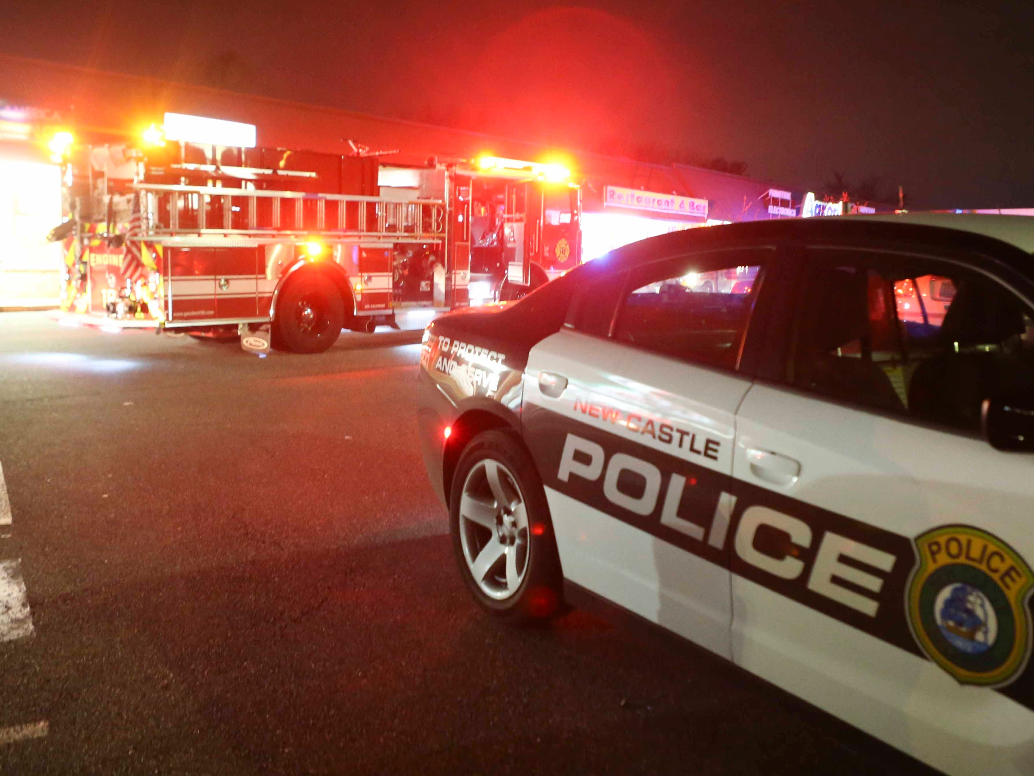 Emergency personnel tend to woman struck and pinned against a storefront wall outside Casa Mariachi restaurant and bar shortly about 11:10 p.m. Friday.