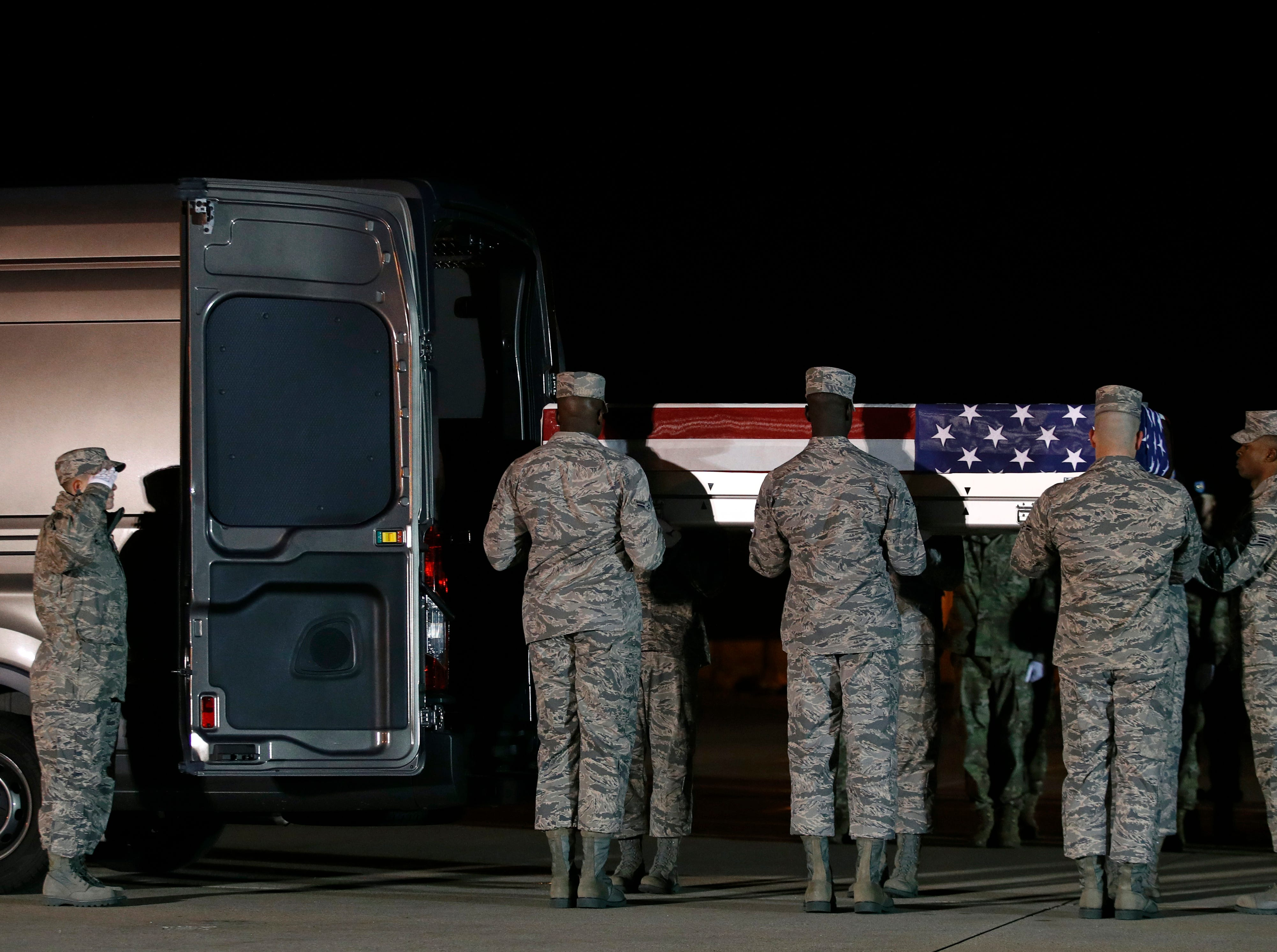 A U.S. Air Force carry team prepares to place a transfer case containing the remains of Staff Sgt. Dylan J. Elchin into a vehicle, Friday, Nov. 30, 2018, at Dover Air Force Base, Del. According to the Department of Defense, Elchin, 25, of Hookstown, Pa., was killed Nov. 27, 2018, by a roadside bomb in Andar, Ghazni Province, Afghanistan.