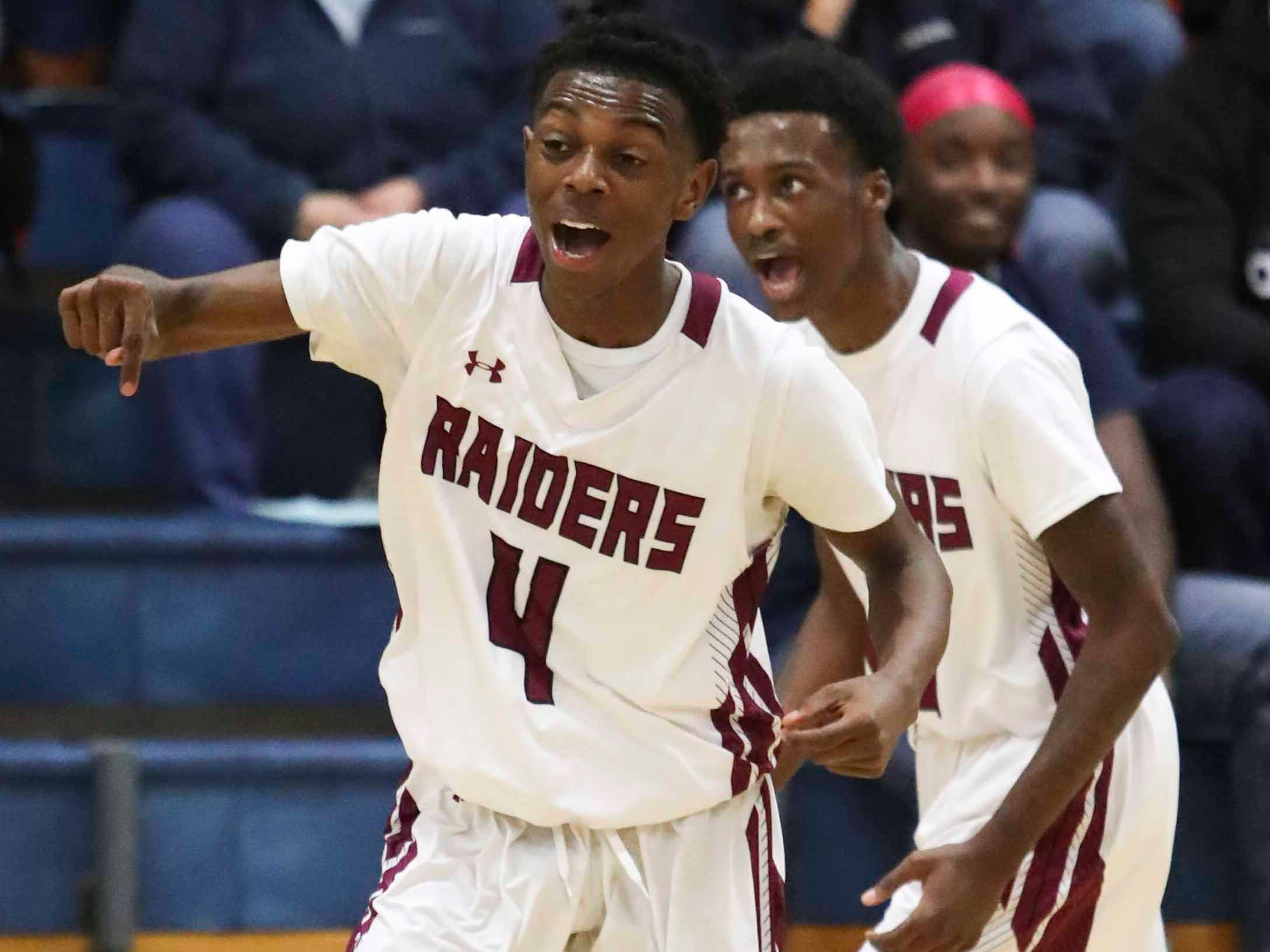 Jamere Crawford (4) and Quadaire Boyer cheer Crawford's buzzer-beater at the end of the first quarter of St. Elizabeth's 61-54 win Friday in the A.I. du Pont Tip-Off Tournament.