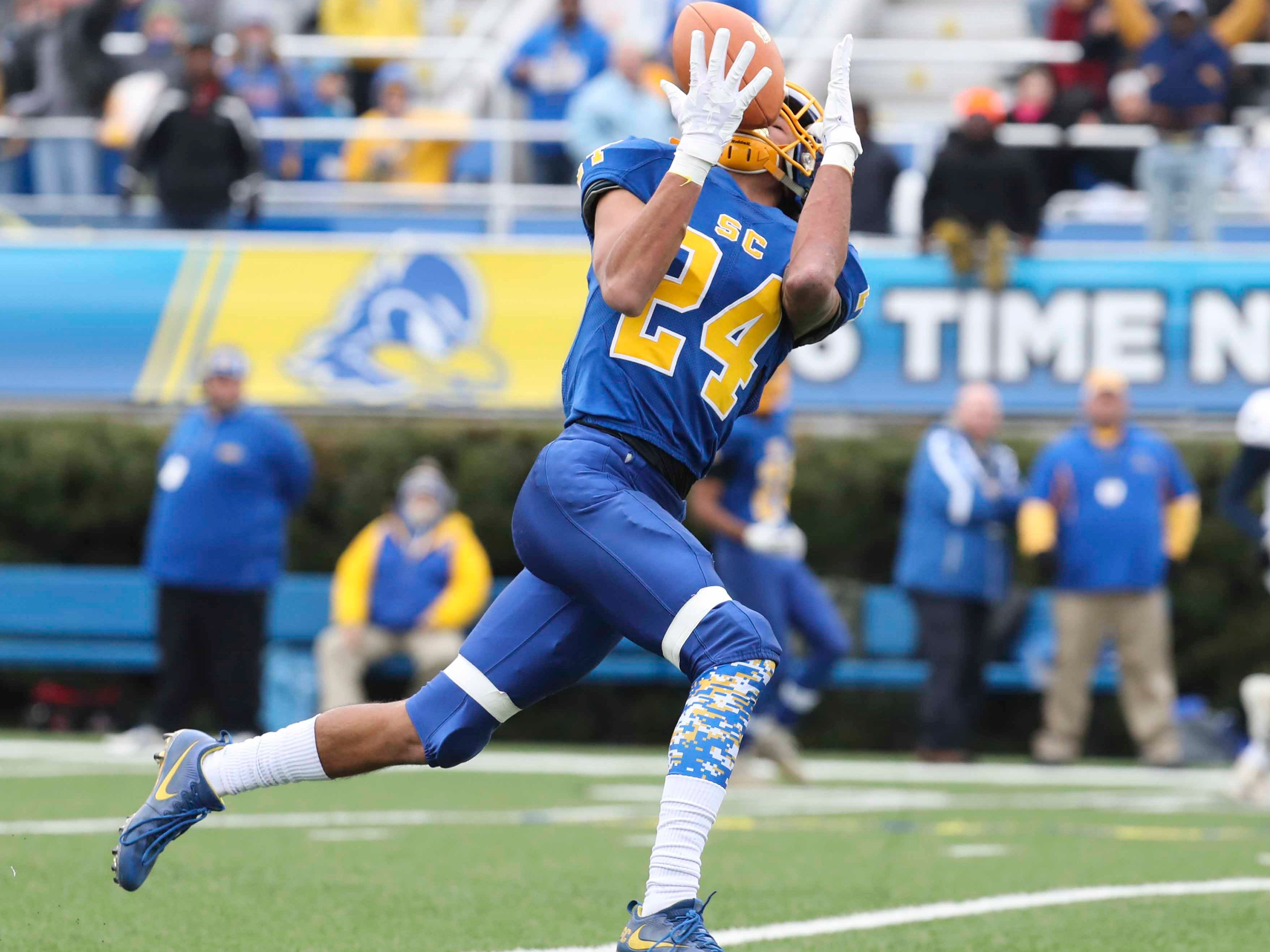 Sussex Central's Isaiah Barnes catches a pass before coasting for a touchdown in the first quarter in the DIAA Division I state tournament championship game at Delaware Stadium Saturday.