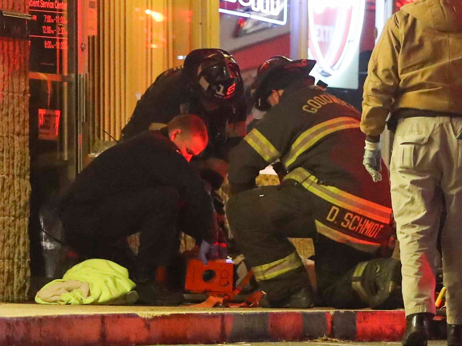 Emergency personnel tend to woman reportedly struck by a van and pinned against a storefront wall outside Casa Mariachi restaurant and bar on East Basin Road about 11:10 p.m. Friday. Information on the victim's condition is not available.