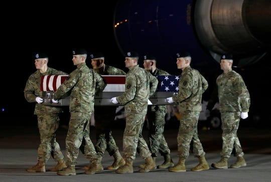 A U.S. Army carry team moves a transfer case containing the remains of Capt. Andrew P. Ross, Friday, Nov. 30, 2018, at Dover Air Force Base, Del. According to the Department of Defense, Ross, 29, of Lexington, Va., was killed Nov. 27, 2018, by a roadside bomb in Andar, Ghazni Province, Afghanistan.