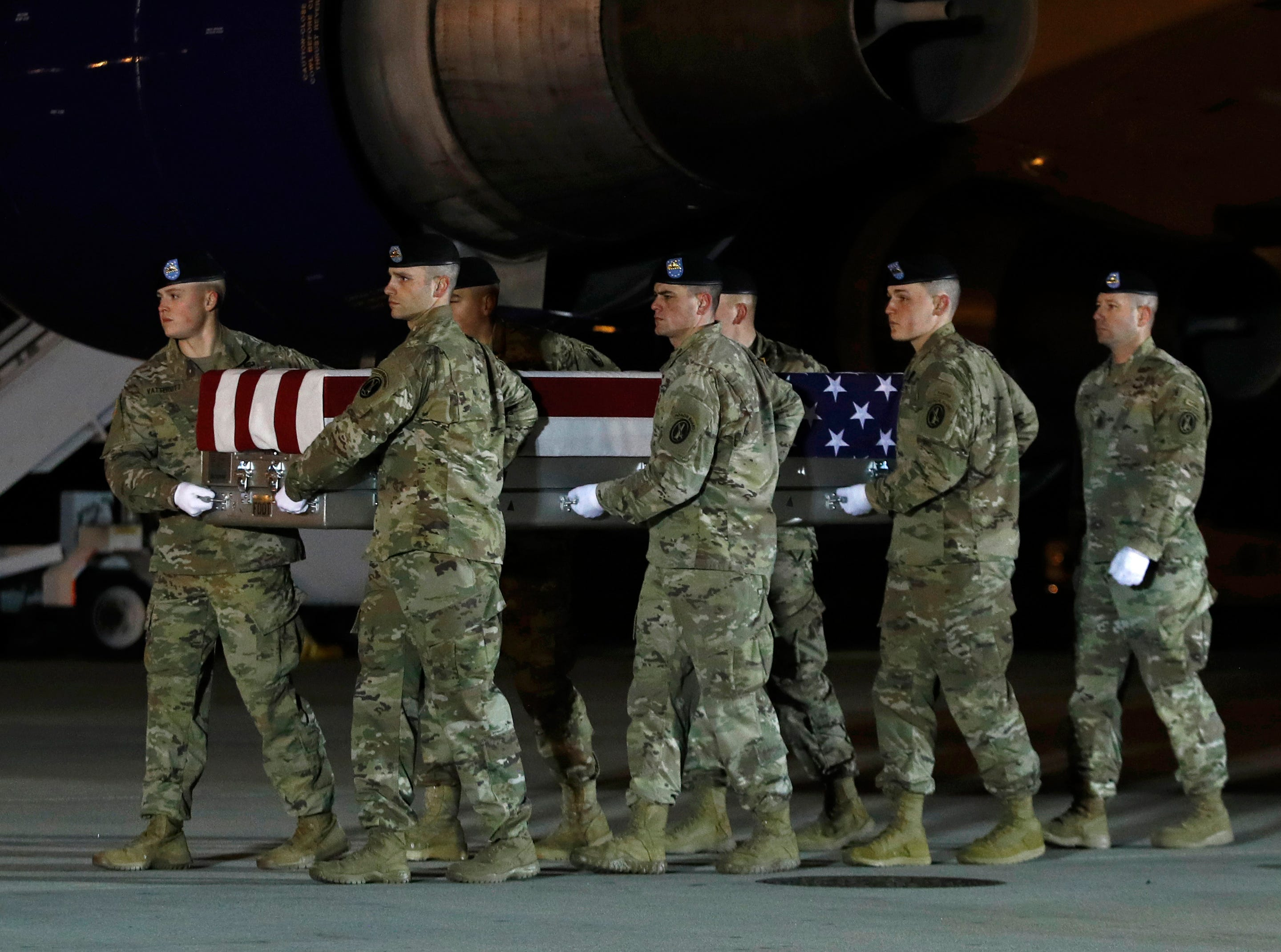 A U.S. Army carry team moves a transfer case containing the remains of Capt. Andrew P. Ross, Friday, Nov. 30, 2018, at Dover Air Force Base, Del. According to the Department of Defense, Ross, 29, of Lexington, Va., was killed Nov. 27, 2018, by a roadside bomb in Ghazni province, Afghanistan.